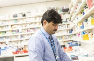 Close-up of pharmacist working in a pharmacy.