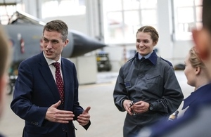 Defence Secretary Gavin Williamson stands alongside female apprentices currently studying STEM trades at the Defence College of Technical Training in RAF Cosford.