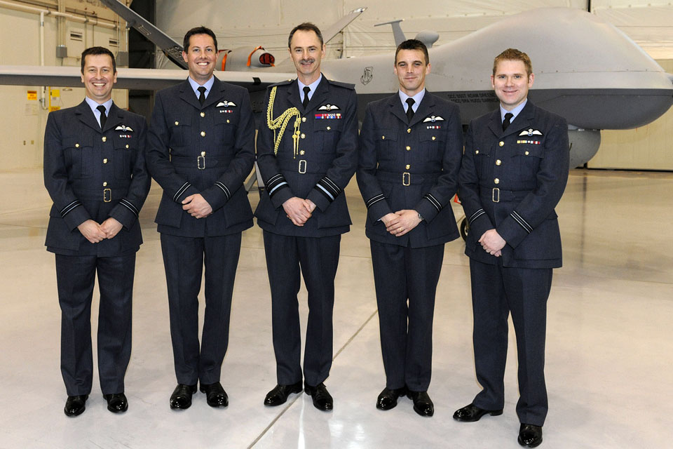 Air Marshal Richard Garwood alongside 4 newly-graduated remotely-piloted aircraft pilots