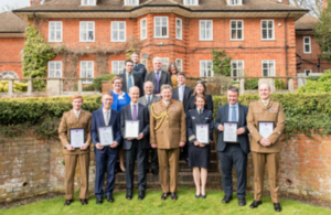 Commander JFC, General Sir Chris Deverell, stood with a group of Commendation recipients.