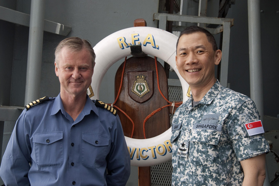Captain Kevin Rimmell (left) with Rear Admiral Giam Hock Koon