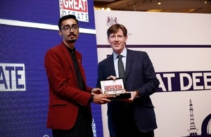 The winner, Haris Ali Virk from Government College University Lahore receiving trophy from Acting British High Commissioner, Richard Crowder.