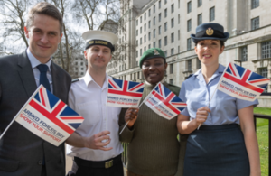 Defence Secretary Gavin Williamson with Service personnel celebrating 100 days to go until Armed Forces Day