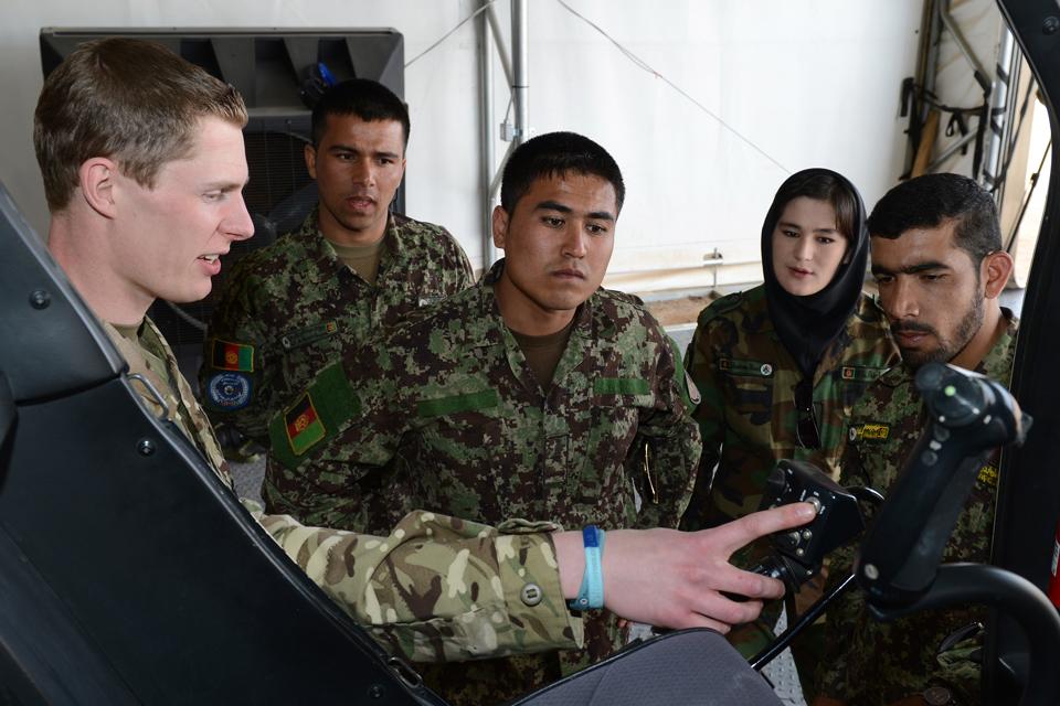 Flight Lieutenant Oliver Burrell mentors Afghan Air Force recruits