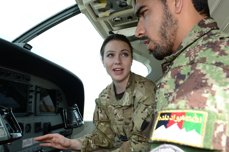 Flight Lieutenant Genevieve Rolleston-Smith with an Afghan Air Force recruit