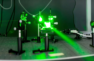A close-up image of a green laser and emitter.