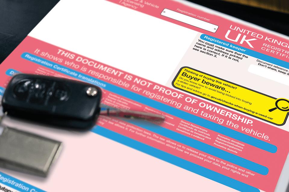 Image of V5C registration certificate with car key on top