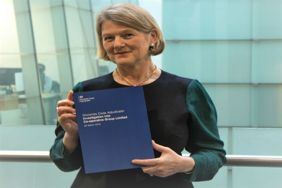 Christine Tacon holding a copy of the investigation report into Co-operative Group Limited.