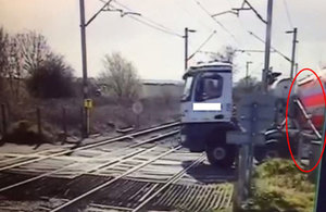 CCTV view of the stationary lorry and partly lowered level crossing barrier (highlighted) courtesy of Network Rail