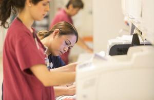 Nurse completing paperwork in hospital