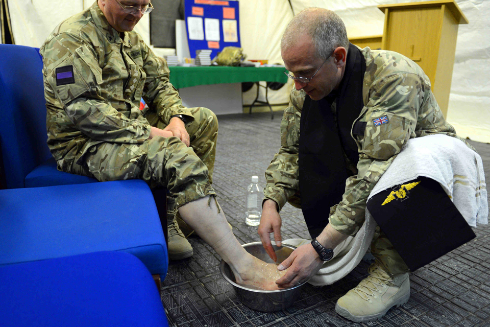 Reverend (Flight Lieutenant) Matt Buchan washes the feet of a serviceman