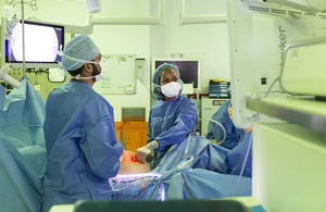 Surgeons operating on a patient