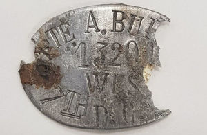 An ID tag that was found with the remains that helped the JCCC identify Pte Burt's remains, Crown Copyright, All rights reserved