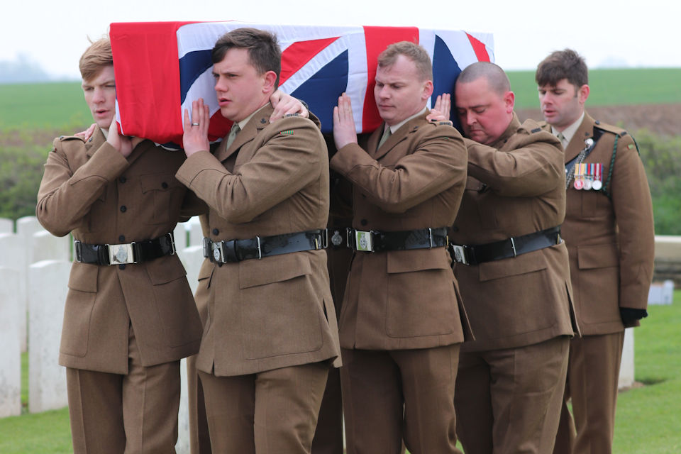 A bearer party from 1 RIFLES carry Private Burt's coffin, Crown Copyright, All rights reserved