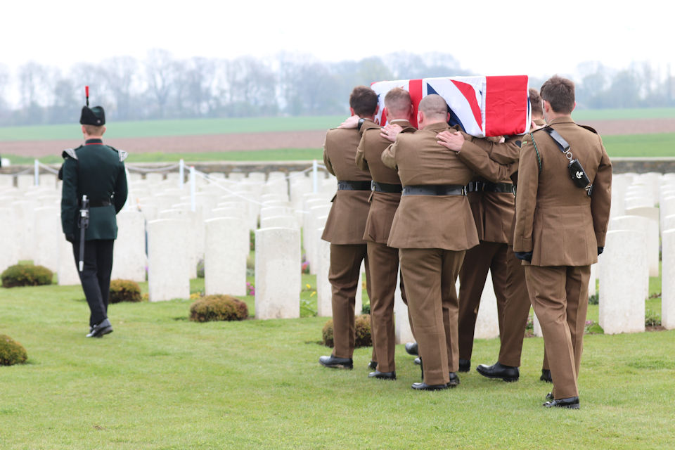 A bugler and bearer party from1 RIFLES carry Private Burt's to the graveside, Crown Copyright, All rights reserved