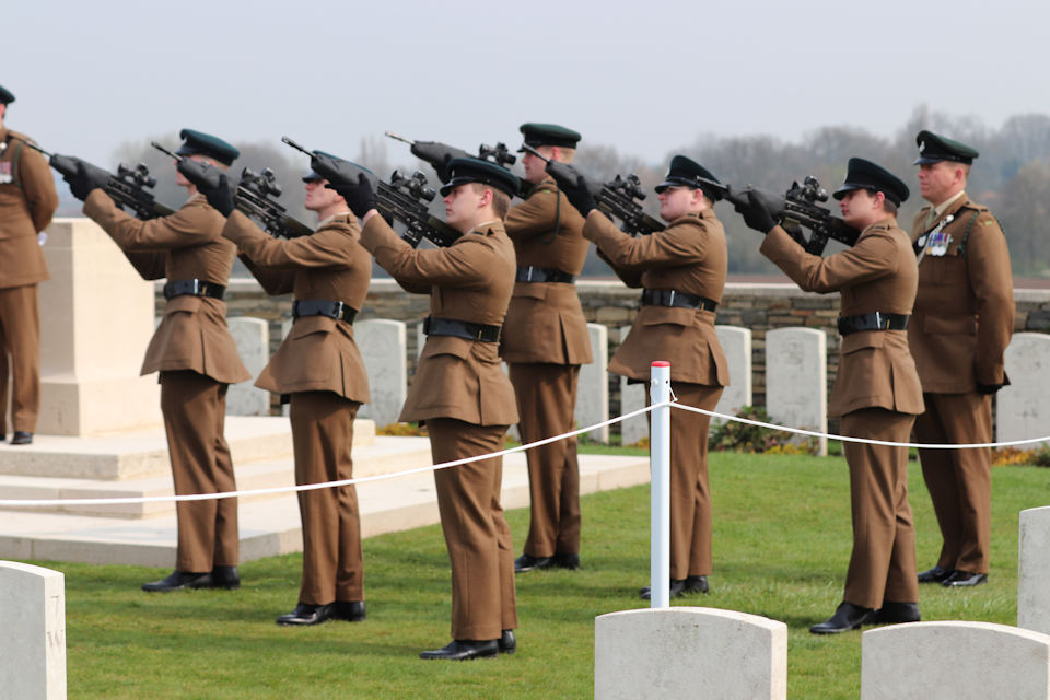 The firing party from 1 RIFLES fire a salute to Private Burt, Crown Copyright, All rights reserved