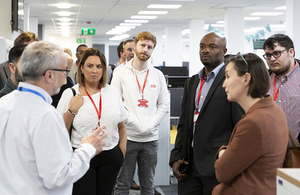 A group of people take a tour of the digital areas at Companies House