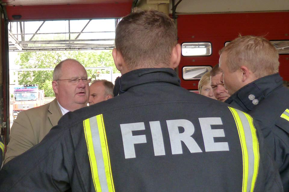 Eric Pickles with firefighters