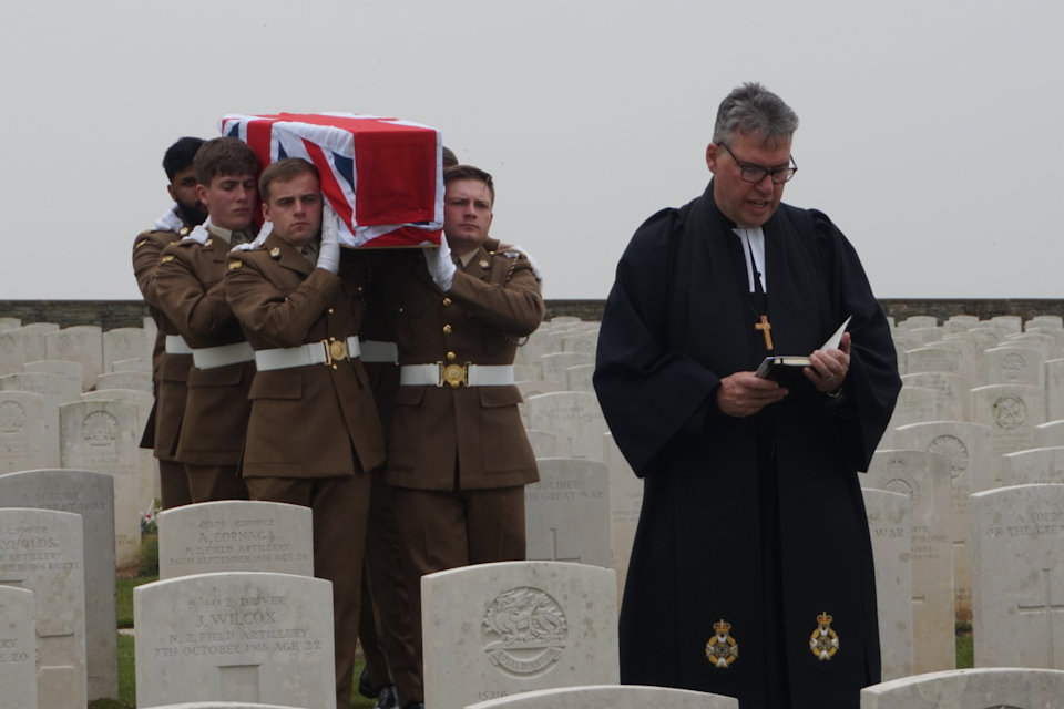 A bearer party from The Mercian Regiment carry the coffin of an unknown soldier into Guards Cemetery, Lesboeufs, led by the Reverend Tim Flowers, Crown Copyright, All rights reserved