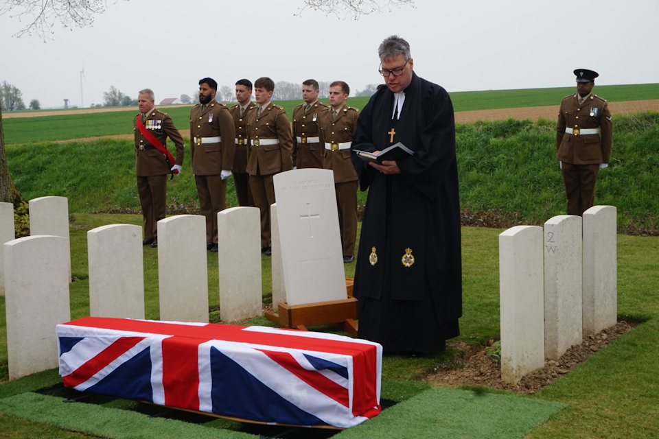 The Reverend Tim Flowers conducts the burial service at the graveside of the unknown soldier in Guards Cemetery, Lesboeufs, Crown Copyright, All rights reserved