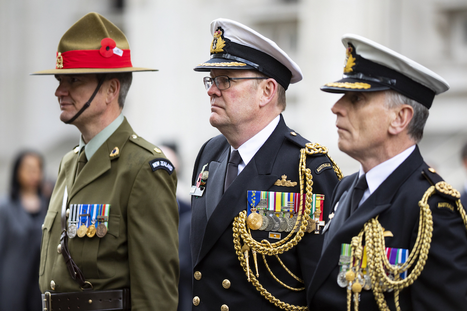 Representatives of New Zealand and Australian armed forces stand at the Cenotaph