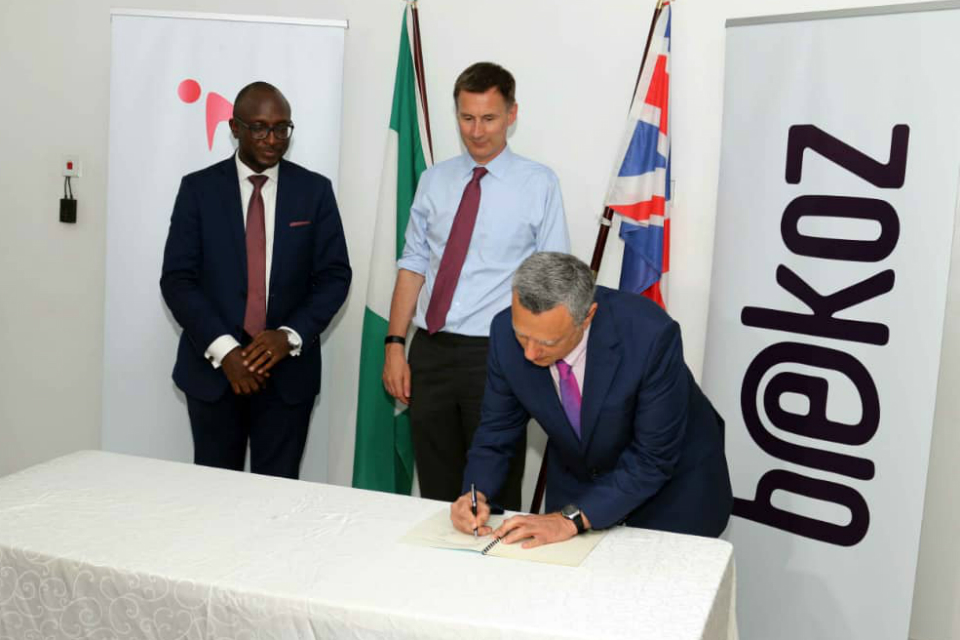 Jeremy Hunt watches representatives of UK company Bekoz and Nigerial company Interswitch GRP sign a £56 million deal.