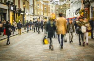 Stock image of people walking through street