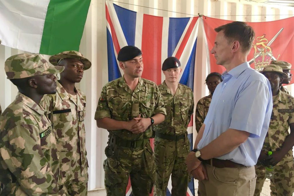 The Foreign Secretary meeting British and Nigerian soldiers.