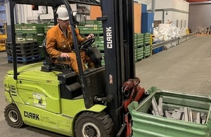 Pieces of boxed metal being moved on a forklift