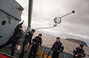 Royal Naval Reserve recruit Charlie Rogers practising rope-throwing - a skill needed when coming alongside to secure vessels [Picture: Crown copyright]