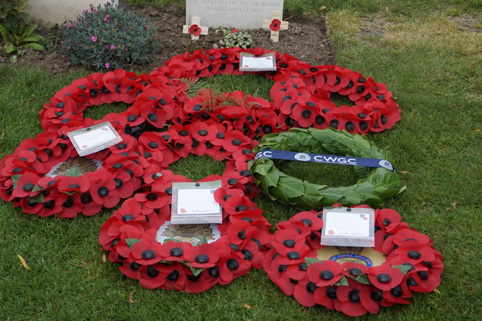 Wreaths lie in front of Pte Foskett's headstone, Crown Copyright, All rights reserved.
