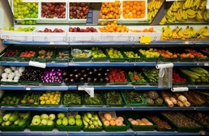A supermarket shelf of fresh produce.