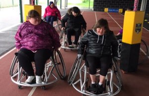 Adults with autism enjoying wheelchair rugby