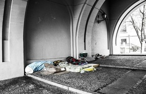 Sleeping bags under an archway for rough sleepers
