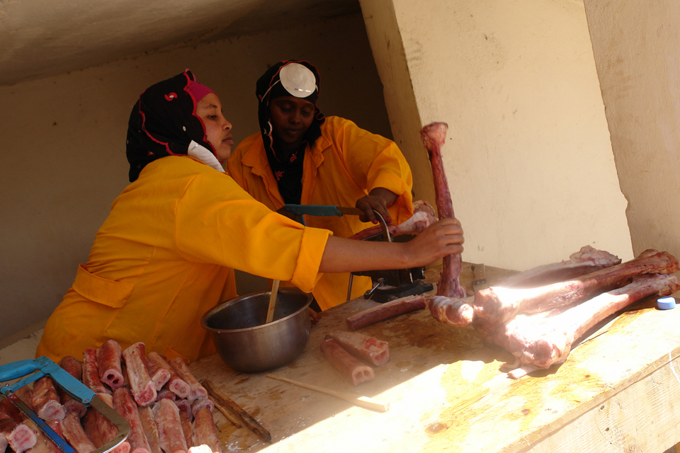 Workers at the Somaliland Meat Development Association soap making plant cut bones in preparation for soap making. Picture: FAO