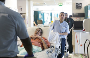 A patient being transferred through the hospital on a bed.