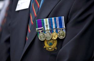 close up of veteran focused on 4 medals