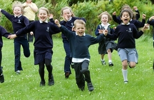 Primary school children running outside