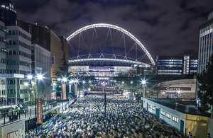 Image of Wembley stadium and famous arch at night time
