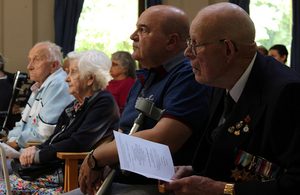 Residents look on during the memorial service. MOD Crown Copyright.