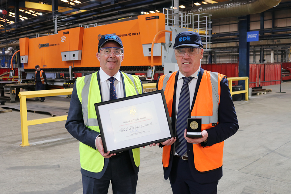 Dr Liam Fox MP presents CDE with a Board of Trade Award (BOFTA)