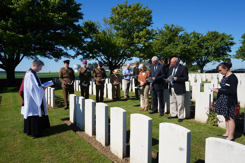 The Revd Ian Kemp CF conducts the rededication service for Capt Edwards at Gouzeaucourt New British Cemetery, Crown Copyright