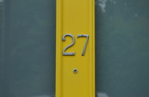 Close up of front door with number 27 on it