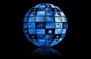 Black background with a blue globe constructed of screens showing various abstract images