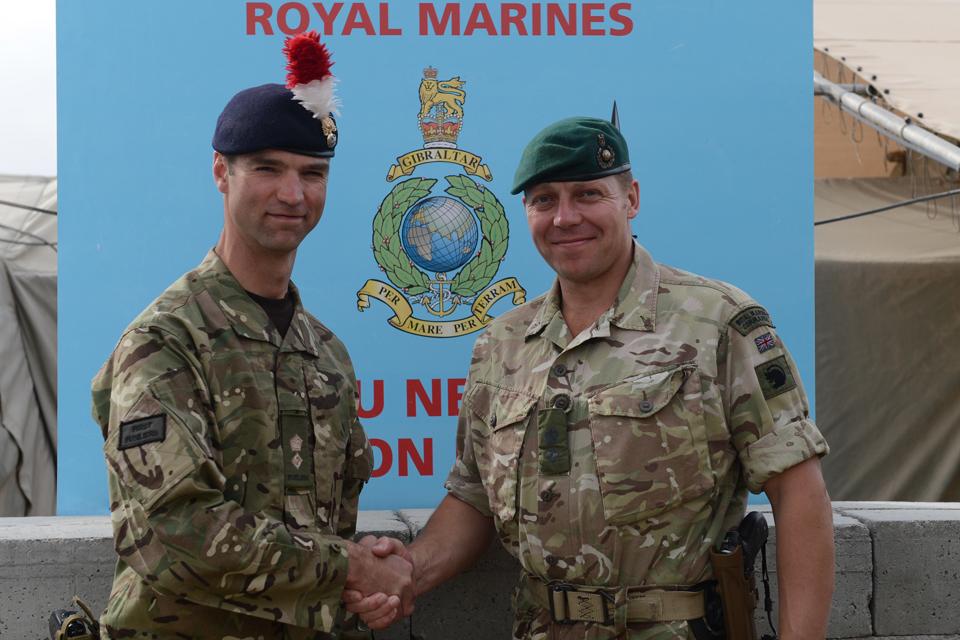 Lieutenant Colonel John Swift shakes hands with Lieutenant Colonel Matt Jackson
