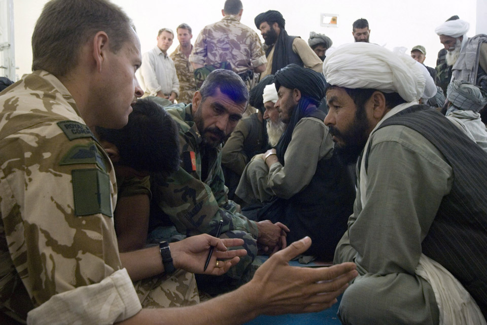A Royal Marines Major talks to an Afghan village elder