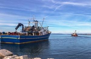 Two Fishing Trawlers at sea