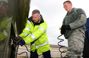 David Cummings (left) trains vehicle operator apprentice Airman 1st Class Dante Armijo of the United States Air Force at RAF Lakenheath [Picture: Staff Sergeant Stephanie Mancha, 48th Fighter Wing Public Affairs, Copyright United States Air Force]