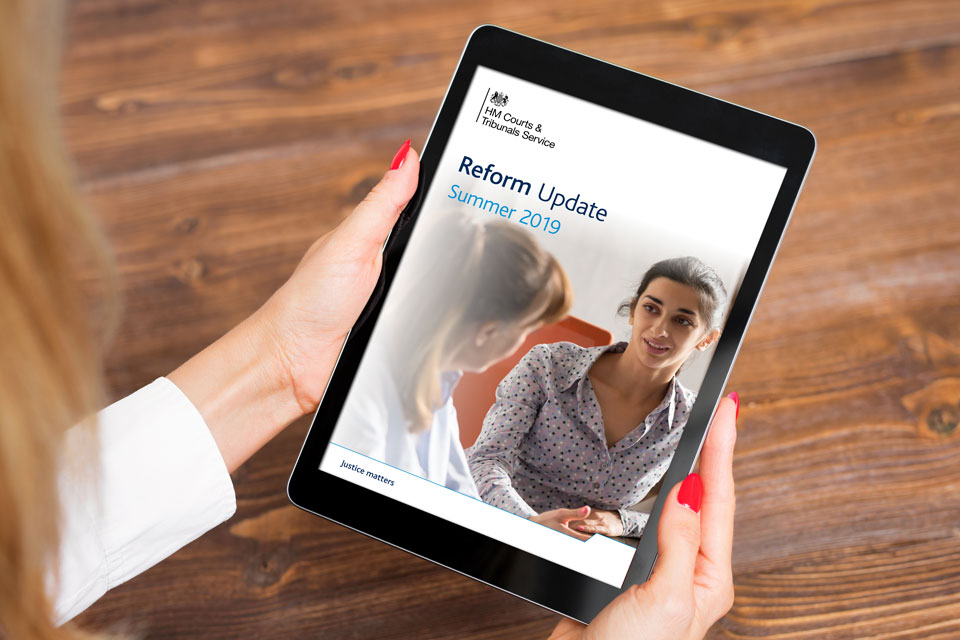 Image of cover of reform update document on a tablet.