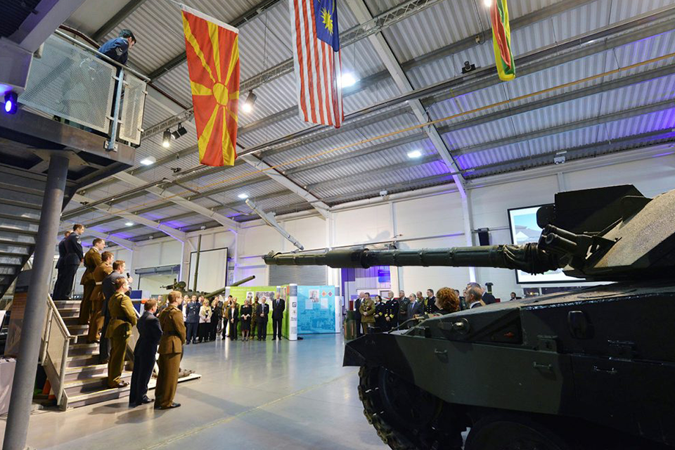 Inside the Defence Academy, personnel gather at the official opening of the Defence Centre for Languages and Culture in 2013.